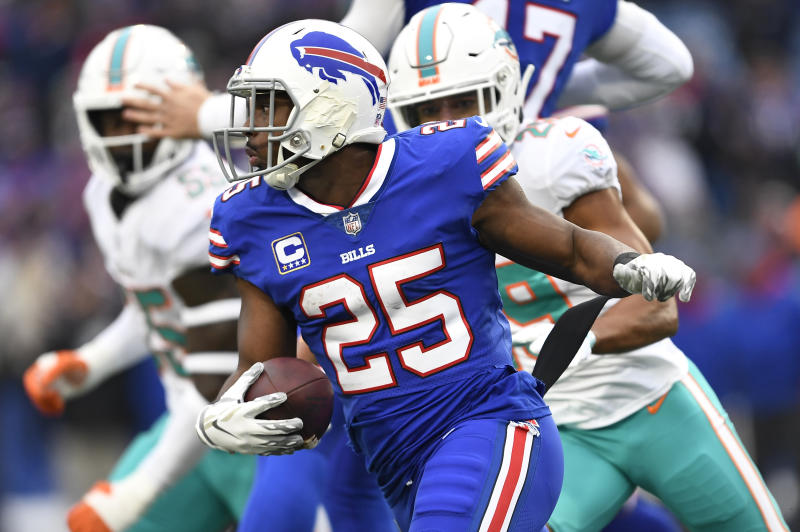 FILE - In this Dec. 30, 2018, file photo, Buffalo Bills running back LeSean McCoy (25) rushes against the Miami Dolphins during the first half of an NFL football game in Orchard Park, N.Y. Running back Frank Gore sees nothing funny about teaming up with McCoy in Buffalo to form the NFL's oldest backfield. Instead, Gore sees no reason why the pair of 30-somethings can't continue their lengthy run of dominance. (AP Photo/Adrian Kraus, File)