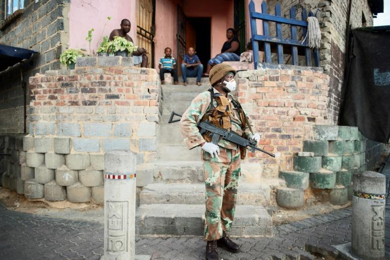 South African troops are enforcing a 21-day lockdown against the virus
