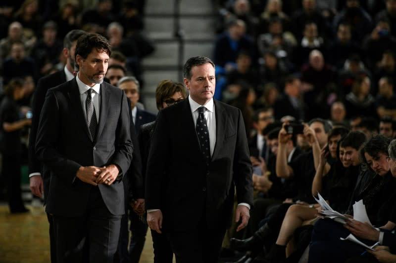 Canadian PM Trudeau tells Iran crash vigil he will pursue justice
