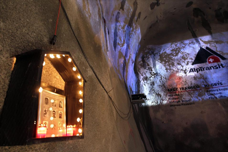 A small chapel in memory of the eight miners killed during the construction of the tunnel hangs at a wall of the Gotthard Base Tunnel near Sedrun in the canton of Grisons, Switzerland, Oct. 15, 2010. With 57 kilometers (35-miles) the new St. Gotthard tunnel is the world's longest tunnel. The 13.157 billion Swiss franc (9.6 billion euros, 13.6 billion US dollars) Alptransit project, which is due to be operational in 2017, constitutes the center piece of the New Railway Link through the Alps. Engineers are expected to start up the massive drilling machine - nicknamed Sissi - at 2 p.m. (1200 GMT; 8 a.m. EDT) so it can chew through the last remaining rock separating the two ends of the 57-kilometer (35.4-mile) Gotthard Base Tunnel.  (AP Photo/Keystone/Arno Balzarini)