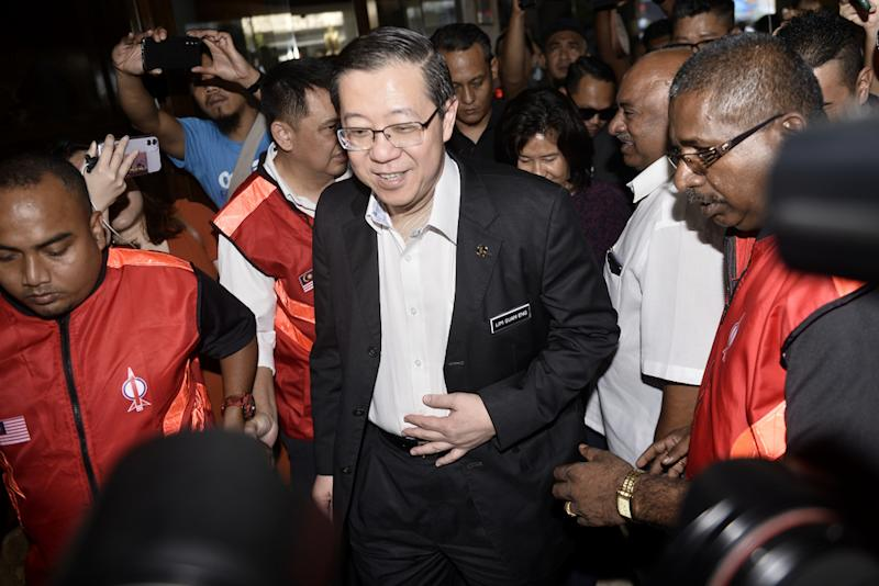 Minister of Finance, Lim Guan Eng arrives for the DAP meeting at the DAP headquarters, February 24, 2020. — Picture by Miera Zulyana