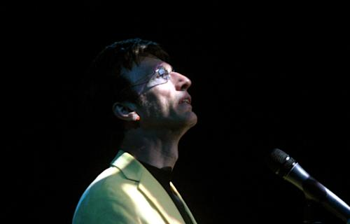 In this Tuesday, Aug. 23, 2005, file, photo, Robin Gibb takes a moment during his concert in Singapore. A representative said on Sunday, May 20, 2012, that Gibb has died. He was 62. (AP Photo/Wong Maye-E, File)