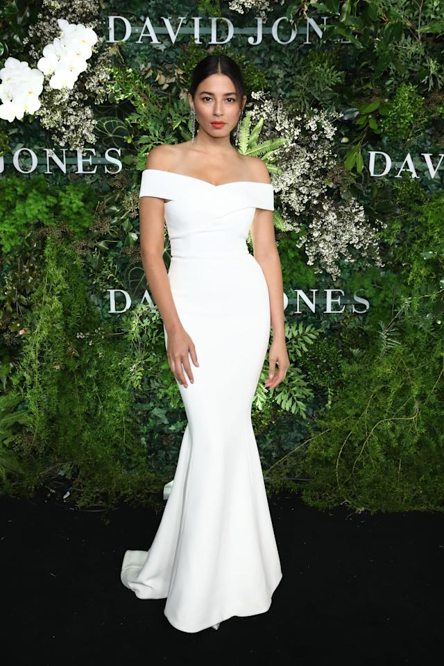 <p>Aussie model Jessica Gomes comanded the catwalk in this figure-hugging white gown and a red lip. Photo: Getty Images </p>