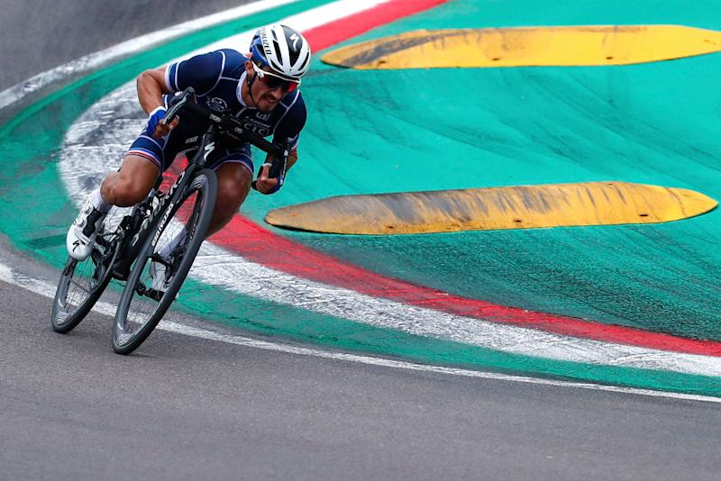 Julian Alaphilippe in a tuck position on the race track, on his way to winning the world title