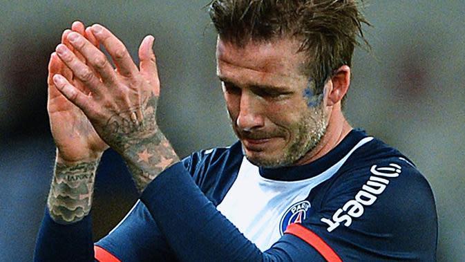 David Beckham menangis pada laga terakhir bersama Paris Saint-Germain. Laga itu juga sebagai tanda Beckham pensiun dari lapangan hijau. (Dok)