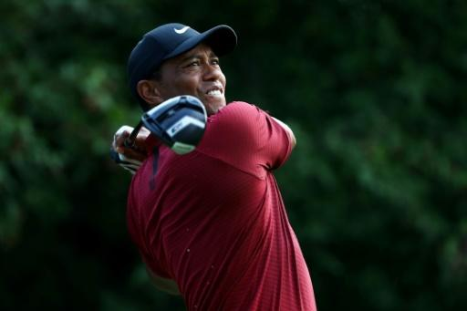 Tiger Woods of the United States plays his shot from the 18th tee