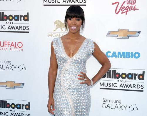 """FILE - This May 19, 2013 file photo shows singer Kelly Rowland at the Billboard Music Awards in Las Vegas. Simon Cowell has added former Destiny's Child singer Kelly Rowland and Latin artist Paulina Rubio to the cast of his competition show """"The X Factor."""" Rowland and Rubio will be on the show when it starts its third season on Fox this fall. They replace Britney Spears and record producer Antonio """"L.A."""" Reid. (Photo by John Shearer/Invision/AP, file)"""