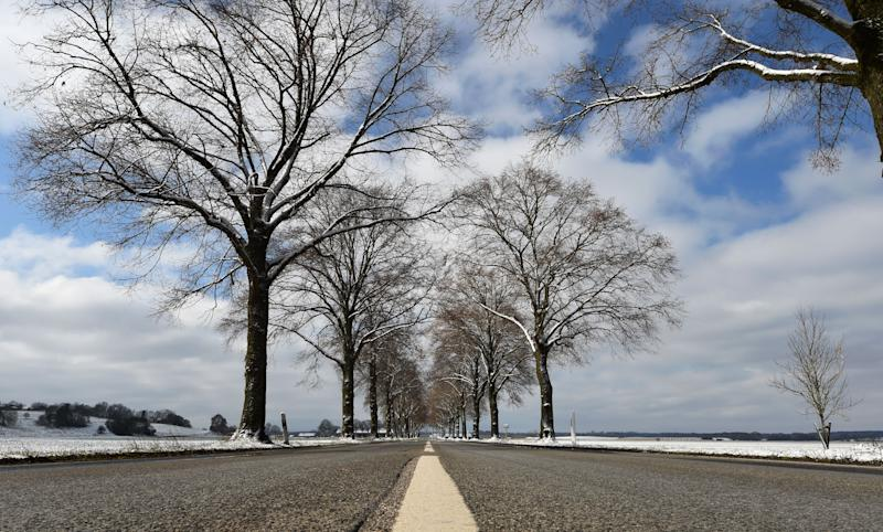 A street is pictured near the small Bavarian village of Alling, southern Germany, after snow fall on March 22, 2020 as more restrictions on daily life have come into force to combat the coronavirus Covid-19 pandemic. (Photo by Christof STACHE / AFP) (Photo by CHRISTOF STACHE/AFP via Getty Images)