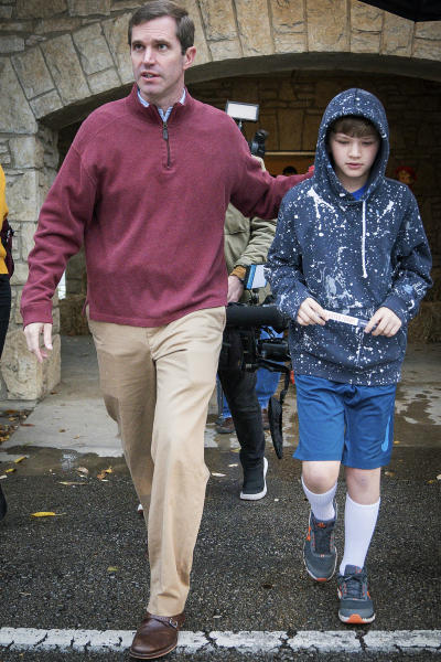 Kentucky Attorney General and Democratic Gubernatorial Candidate Andy Beshear, and his son Will, 10, depart the Knights of Columbus polling location, Tuesday, Nov. 5, 2019, in Louisville, Ky. (AP Photo/Bryan Woolston)