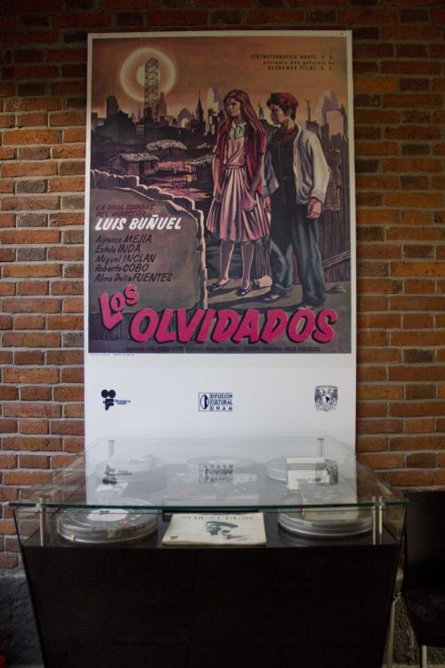 "In this Aug. 1, 2013 photo, a poster of the movie ""Los Olvidados"" hangs on the wall at the ""Casa Bunuel"" in Mexico City. Despite that colorful legacy, Bunuel's home is being presented as simply as the director left it, and not with the museum treatment given to the much-visited Mexico City abodes of Russian revolutionary Leon Trotsky and surrealist painter Frida Kahlo. (AP Photo/Gabriela Sanchez)"