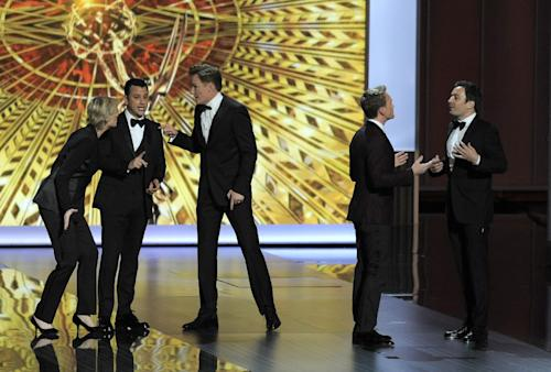 Jane Lynch, from left, Jimmy Kimmel, Conan O' Brien, Neil Patrick Harris, and Jimmy Fallon speak on stage at the 65th Primetime Emmy Awards at Nokia Theatre on Sunday Sept. 22, 2013, in Los Angeles. (Photo by Chris Pizzello/Invision/AP)