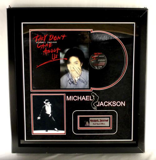 "This undated photo provided by Texas-based Gaston & Sheehan Auctioneers, Inc. shows a Michael Jackson autographed record album titled ""They Don't Care About Us"" that once belonged to former Illinois Congressman Jesse Jackson Jr. It is among the items the U.S. Marshals Service started selling in an online auction Tuesday, Sept. 17, 2013, in its attempt to recoup part of the $750,000 in campaign funds the Chicago Democrat and his wife illegally spent. Both were handed prison terms last month. The auction runs through Sept. 26. (AP Photo/Courtesy Gaston & Sheehan Auctioneers, Inc.)"