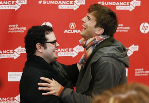 """Actors Ashton Kutcher, right, who portrays Steve Jobs, and Josh Gad, right, who portrays Steve Wozniak, left, greet each other at the premiere of """"jOBS"""" during the 2013 Sundance Film Festival on Friday, Jan. 25, 2013, in Park City, Utah. (Photo by Danny Moloshok/Invision/AP)"""
