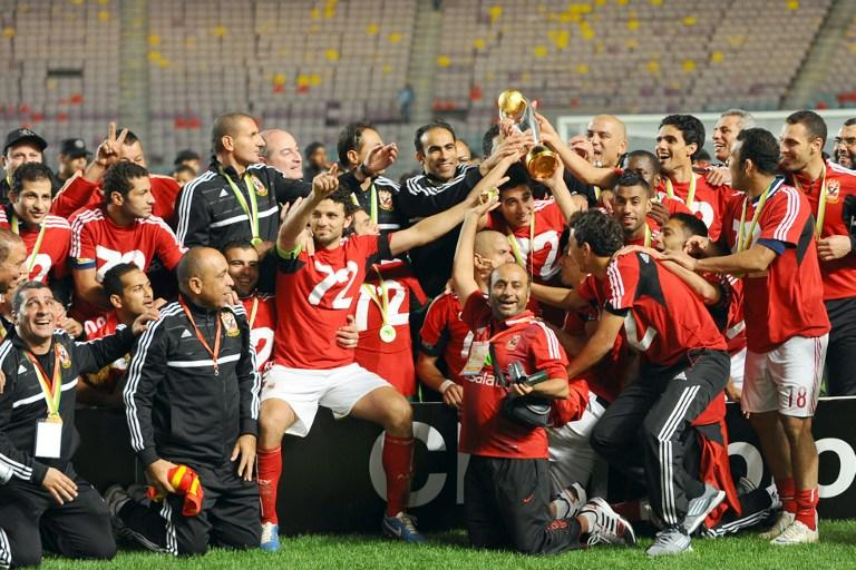 Egypt's al-Ahly team pose with the trophy after winning 2-1 against Esperance de Tunis in their CAF Confederation Cup football final at Rades Olympic stadium near Tunis, on November 17