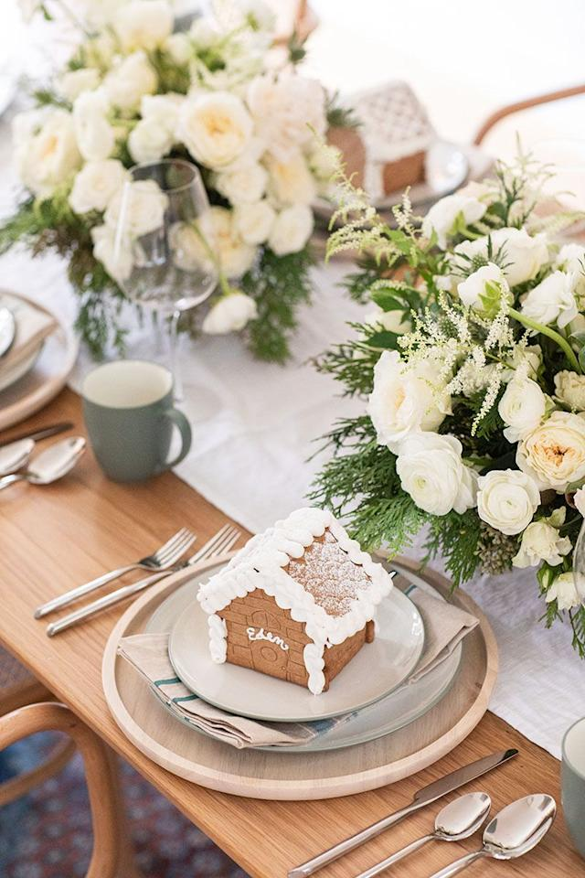 """<p>If there's anything more charming than this mini gingerbread house/place card, we don't know what it is! The tiny house doubles as a personalized favor that's totally edible! </p><p><strong>See more at <a href=""""https://sugarandcharm.com/christmas-eve-dinner"""" target=""""_blank"""">Sugar and Charm</a>. </strong></p>"""