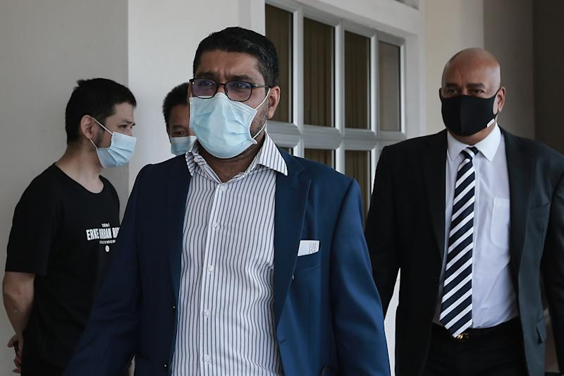 Former psychiatrist Dr Gurdeep Singh (left) is seen at the Magistrate's Court in Petaling Jaya August 14, 2020. ― Picture by Ahmad Zamzahuri