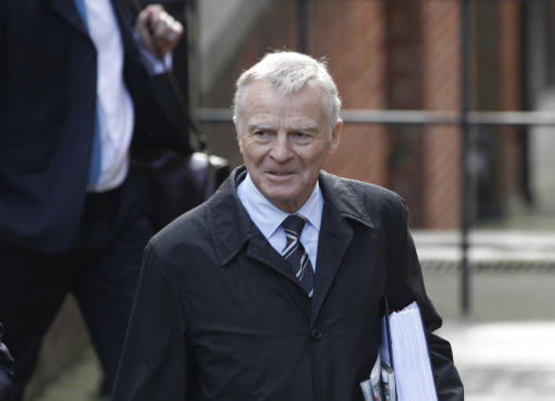 Max Mosley, former FIA president arrives to testify at the Leveson inquiry at the Royal Courts of Justice in central London, Thursday, Nov. 24, 2011. The Leveson inquiry is Britain's media ethics probe that was set up in the wake of the scandal over phone hacking at Rupert Murdoch's News of the World, which was shut in July after it became clear that the tabloid had systematically broken the law. (AP Photo/Lefteris Pitarakis)