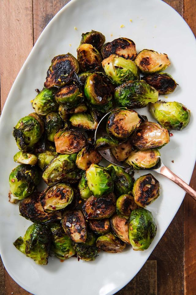 """<p>Throw in chili flakes, oregano, or any of your fave flavors.</p><p>Get the recipe from <a href=""""https://www.delish.com/cooking/recipe-ideas/a22566331/best-sauteed-brussel-sprouts-recipe/"""" target=""""_blank"""">Delish</a>. </p>"""