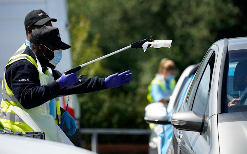 Serco staff working on behalf of NHS Test and Trace operate a coronavirus testing centre - Getty Images Europe
