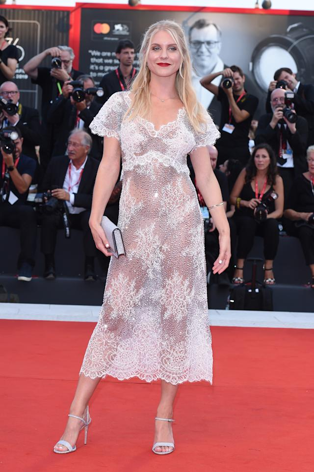 Another guest arrives in a see-through dress at The Laundromat premiere. Photo: Getty