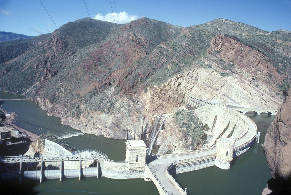 "<p>Once known as the world's largest masonry dam—a title now bestowed upon the <a href=""https://guntur.ap.gov.in/tourist-place/nagarjuna-sagar-dam/"" target=""_blank"">Nagarjuna Sagar Dam</a> in India—the Theodore Roosevelt Dam was originally constructed between 1905 and 1911. The premise was simple: <a href=""https://www.srpnet.com/water/dams/roosevelt.aspx"" target=""_blank"">halt the wayward flow</a> of the Salt River to irrigate the harsh Arizona desert, making it more amenable to farming.</p><p>When it was first constructed, the dam made use of a Greco-Roman style that favored large, irregularly shaped blocks. However, following a $430 million renovation project in 1996, the dam was covered in new concrete, masking the masonry.  </p><p>The structure is named for President Theodore Roosevelt, who was instrumental in passing the Federal Reclamation Act of 1902, which funded irrigation projects in the West. At completion, the resulting reservoir–Theodore Roosevelt Lake—came in at <a href=""https://theculturetrip.com/north-america/usa/articles/americas-5-greatest-dams/"" target=""_blank"">526,875 acre-feet</a> of water, making it the largest manmade lake at the time.</p>"