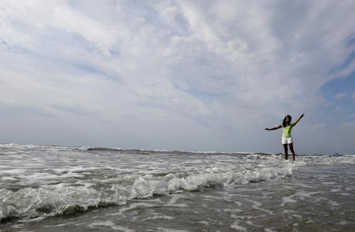 Miss America 2014 Nina Davuluri poses for photographers during the traditional dipping of the toes in the Atlantic Ocean the morning after being crowned Miss America, Monday, Sept. 16, 2013, in Atlantic City, N.J. Davuluri represented New York. (AP Photo/Julio Cortez)