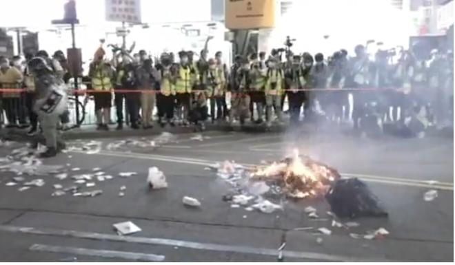 Rubbish was set on fire on a road in Mong Kok. Photo: Cable TV News