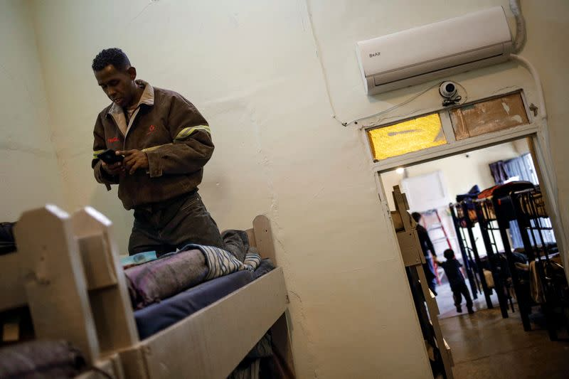 A migrant from Central America, sent back to Mexico to await his outcome of his case under the Migrant Protection Protocols (MPP), is pictured at El Buen Pastor shelter in Ciudad Juarez