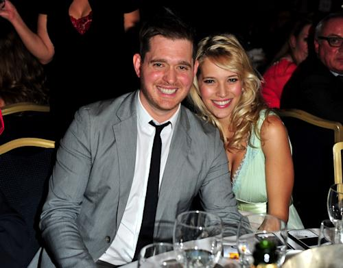 "FILE - In this June 29, 2012 file photo, singer Michael Buble and his wife, Argentine TV actress Luisana Lopilato, pose at the Nordoff Robbins 02 Silver Clef Awards at London Hilton, in London. His new album, ""To Be Loved,"" will be released April 23 and includes a tribute to his wife. They announced in January their expecting their first child. (Photo by Jon Furniss/Invision/AP, File)"