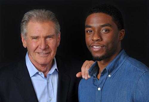 "In this Saturday, March 23, 2013 photo, Harrison Ford. left, and Chadwick Boseman, cast members in the film ""42,"" pose together for a portrait, in Los Angeles. In the new movie by writer-director, Brian Helgeland, Boseman plays Jackie Robinson and Ford plays Brooklyn Dodgers president and general manager Branch Rickey. Helgeland, an Oscar winner for his ""L.A. Confidential"" screenplay who previously directed ""Payback"" and ""A Knight's Tale,"" said he felt ""an enormous amount of pressure"" to be faithful to Robinson's story, both because of his significance and because his life had been written about so extensively. (Photo by Chris Pizzello/Invision/AP)"