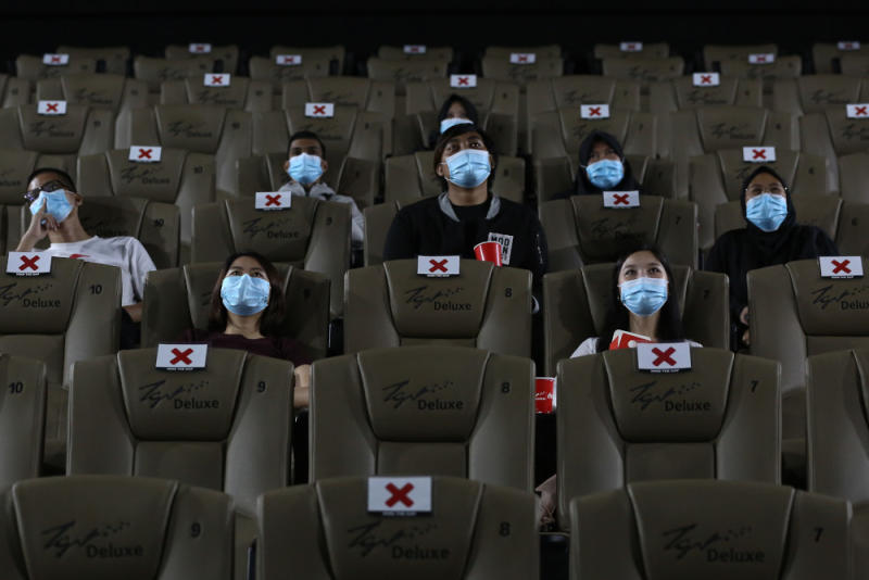 People wearing protective face masks observe social distancing guidelines while watching a movie at a TGV cinema in Central I-City, Shah Alam July 1, 2020. — Picture by Yusof Mat Isa