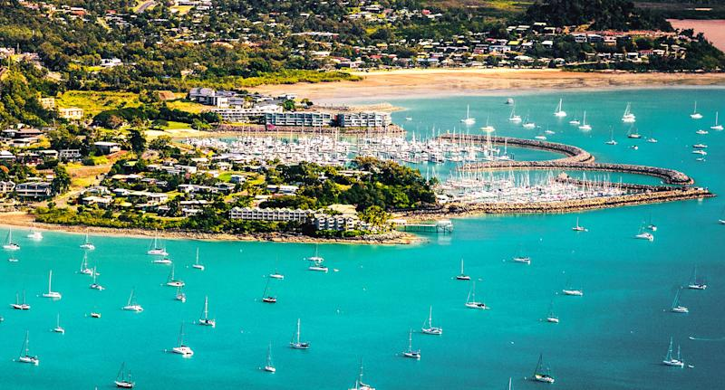 Two swimmers are attacked by a shark near Airlie Beach in Queensland