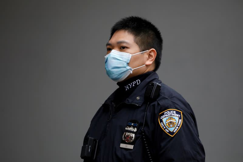 FILE PHOTO: A New York Police Department officer is seen in a protective mask during the coronavirus disease (COVID-19) outbreak in the Manhattan borough of New York City