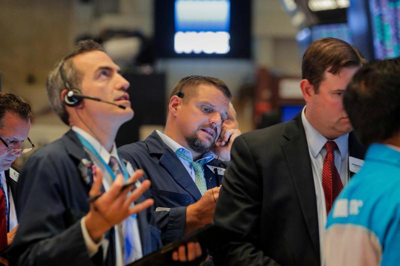 Traders work on the floor at the New York Stock Exchange (NYSE) in New York, U.S., September 18, 2019. REUTERS/Brendan McDermid