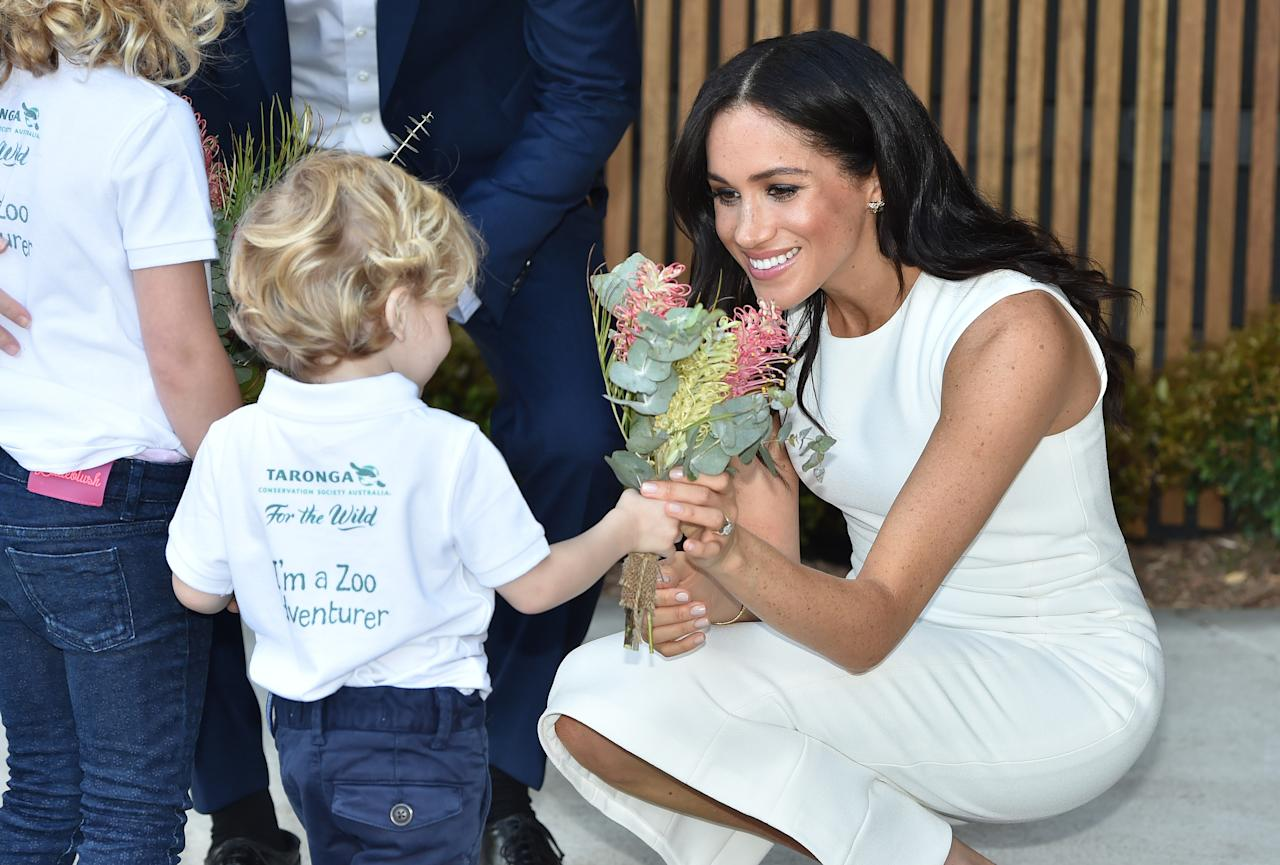 """<p>Meghan was positively glowing in a <a rel=""""nofollow"""" href=""""https://au.lifestyle.yahoo.com/pregnant-meghan-markle-wears-1-slideshow-wp-222400579.html"""">$1,800 ivory dress by Australian designer Karen Gee</a>, that was conveniently called the """"Blessed Dress"""". Photo: Getty </p>"""