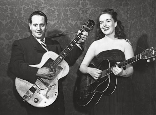 "FILE - In this Nov. 5, 1951 file photo, Les Paul and his wife, Mary Ford, strum their guitars at an unknown location. Les Paul was a renown musician also known for his innovations on the solid body electric guitar and multitrack recording. He also earned 36 gold records for hits with his wife Mary Ford including ""Vaya Con Dios"" and ""How High the Moon,"" which both hit No. 1 on the Billboard charts. The man who helped pave the way for rock 'n' roll is finally getting a permanent exhibit on June 9, 2013 at the Waukesha County Museum in his Wisconsin hometown. (AP Photo)"
