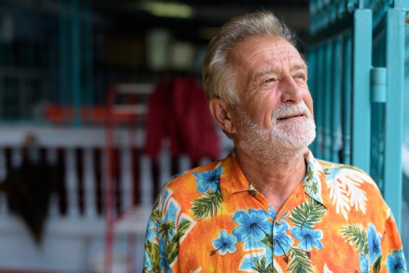 older man wearing orange floral shirt, over 50 regrets