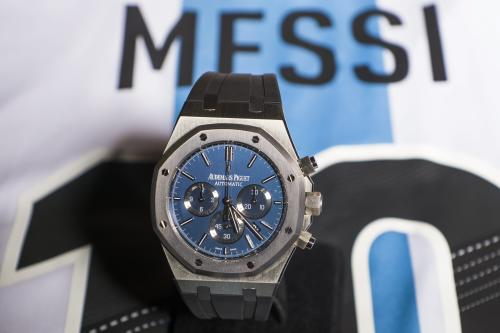 FILE - This is a Tuesday, May 7, 2013 file photo of the Royal Oak Chronograph Leo Messi No. 10 by Audemas Piguet, is pictured with the jersey of the national soccer team of Argentina during an auction preview at Sotheby's in Geneva, Switzerland. Barcelona star Lionel Messi's Audemars Piguet No. 10 Royal Oak Chronograph wristwatch, was sold for $81,850 to raise money for the four-time FIFA player of the year's foundation. (AP Photo/Keystone/Jean-Christophe Bott, File)