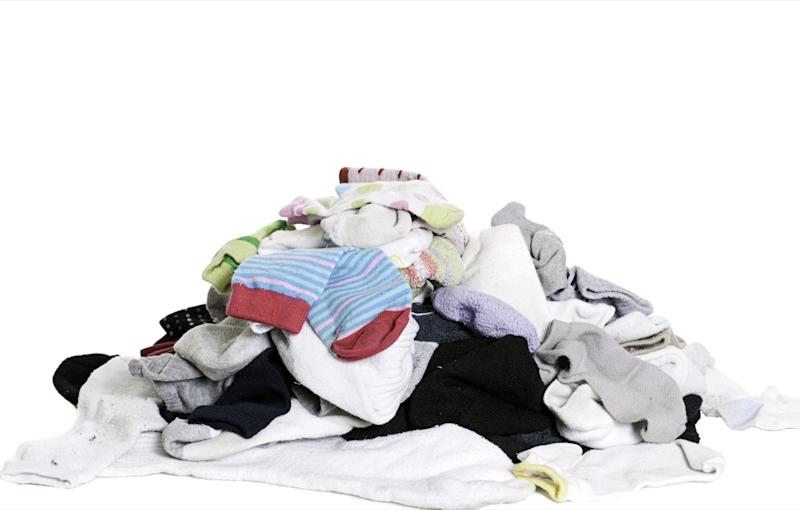 pile of mismatched socks toss these things from your house for instant happiness