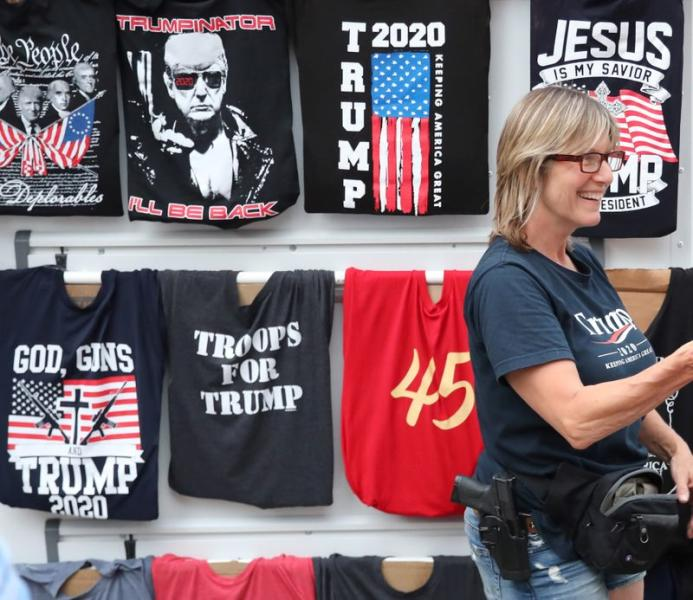 A woman sells T-shirts near the BOK Center in Tulsa