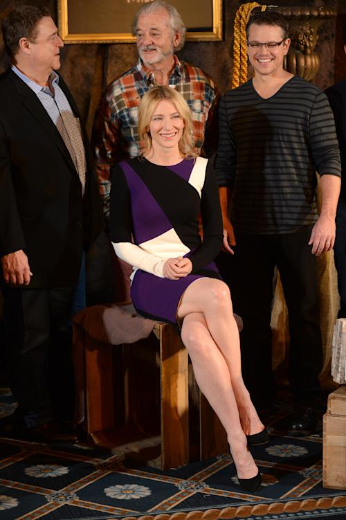 "In this Thursday, Jan. 16, 2014 photo, actress Cate Blanchett poses with cast members, rear, John Goodman, Bill Murray and Matt Damon, during a photocall for ""The Monuments Men"" at the Four Seasons Hotel in Los Angeles. The World War II drama opens Friday, Feb 7, 2014. Based on a true story, the film is adapted from Robert Edsel's book, ""The Monuments Men: Allied Heroes, Nazi Thieves and the Greatest Treasure Hunt in History."" (Photo by Jordan Strauss/Invision/AP)"