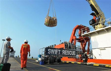 The Singaporean submarine support and rescue vessel, MV Swift Rescue, is prepared before it departs to assist in the search for missing Malaysian Airlines flight MH370 in Singapore, in this March 9, 2014 handout picture. REUTERS/Singapore MINDEF/Handout via Reuters