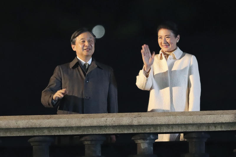 Japanese Emperor Naruhito and Empress Masako wave as they make a public appearance during a ceremony to mark his enthronement in Tokyo Saturday, Nov. 9, 2019. Naruhito thanked tens of thousands of well-wishers who gathered outside the palace to congratulate his enthronement at the ceremony organized by conservative political and business groups. (AP Photo/Koji Sasahara, Pool)