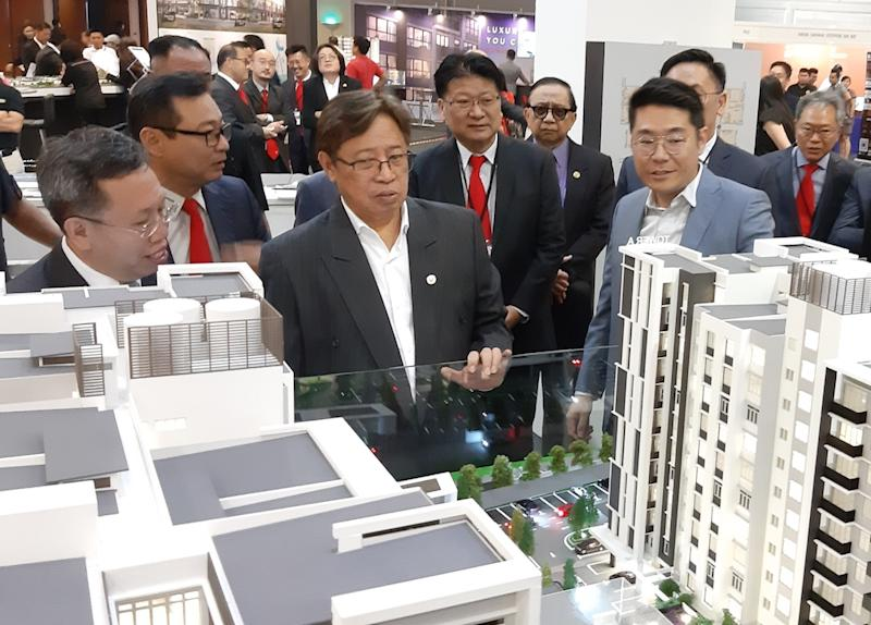 Chief Minister Datuk Patinggi Abang Johari Openg looks at models of high-rise buildings during the Sarawak Property Expo in Kuching September 20, 2019. — Picture by Sulok Tawie