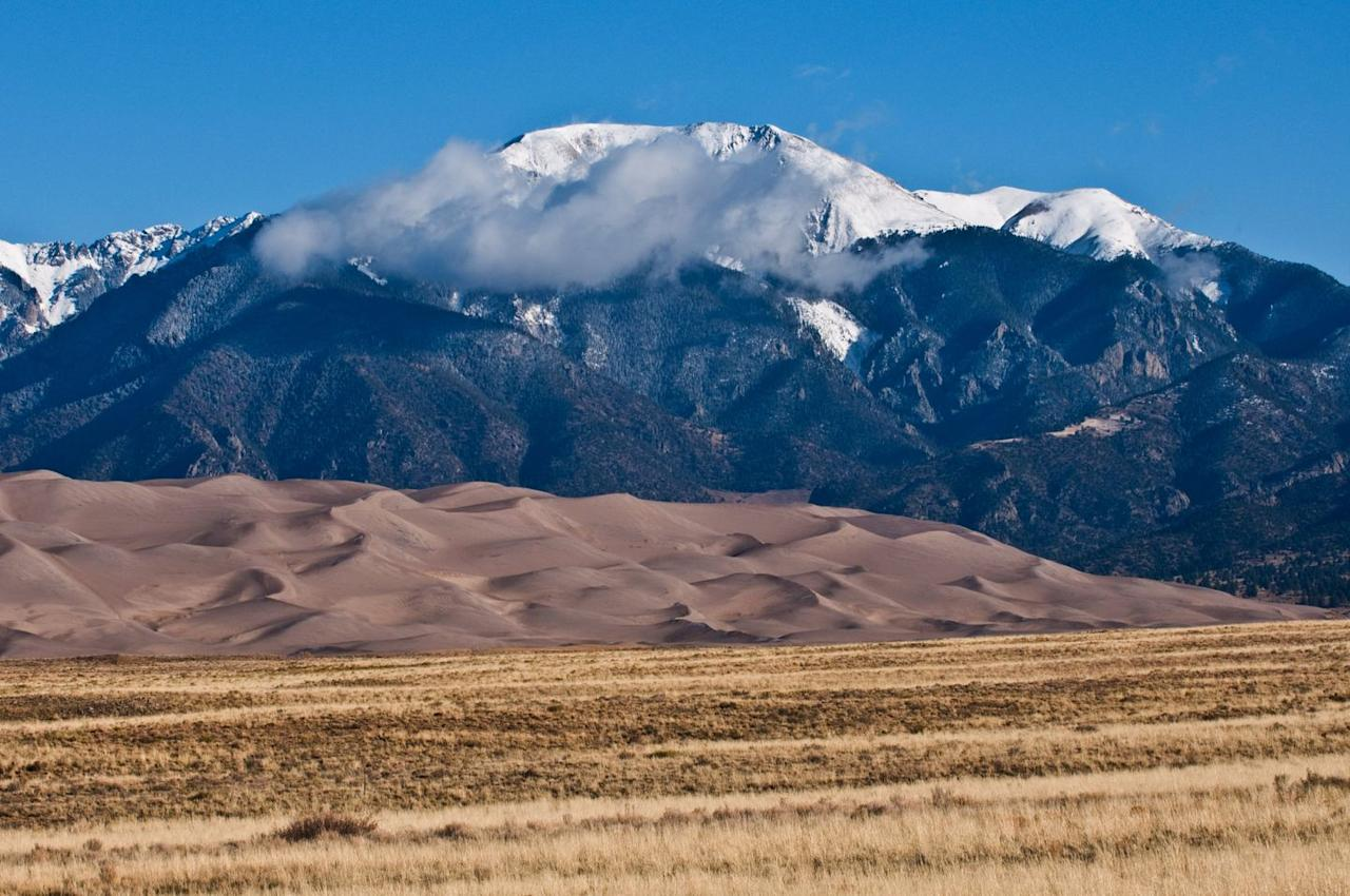 """<p>Think of the <a href=""""https://www.nps.gov/grsa/index.htm"""" target=""""_blank"""">Great Sand Dunes National Park</a> in Colorado as an extremely sandy beach. The selling point of this underrated spot is the springtime when the Medano Creek floods. The waters go down into the San Luis Valley and turn the dunes into a temporary lake completely with waves. The park features the tallest sand dunes in North America, as well as snow at its highest peak. </p>"""