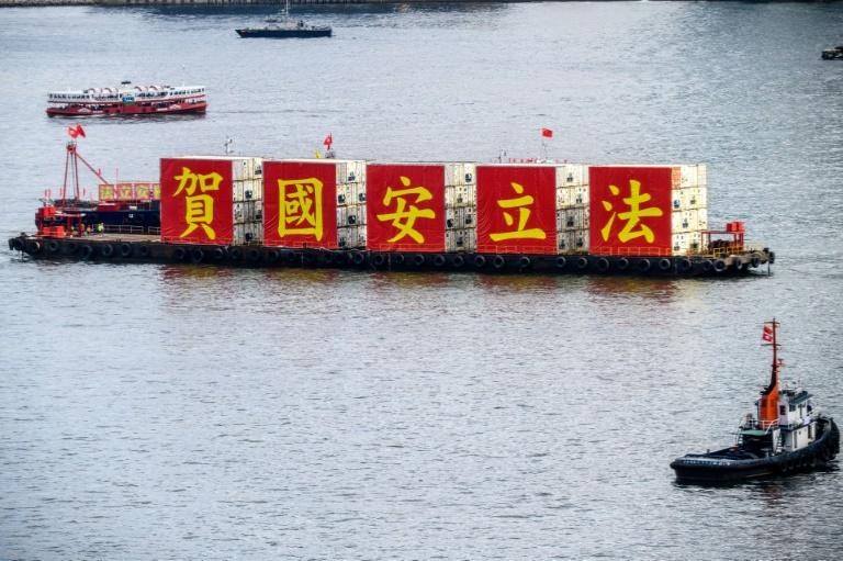 A barge with banners marking the passing of the national security law floats in Victoria Harbour on the 23rd anniversary of Hong Kong's handover from Britain to China
