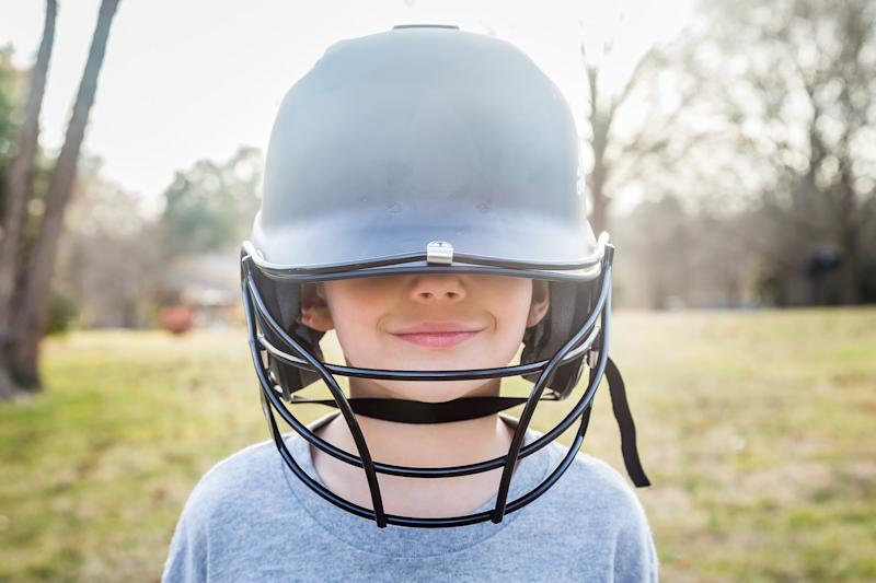 Generic photo of a child with a baseball helmet