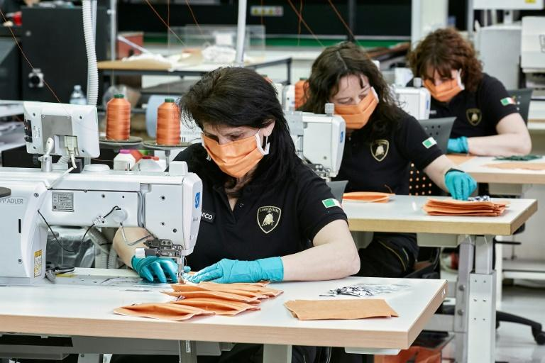Many clothing manufacturers, like this one in Italy, are now making masks