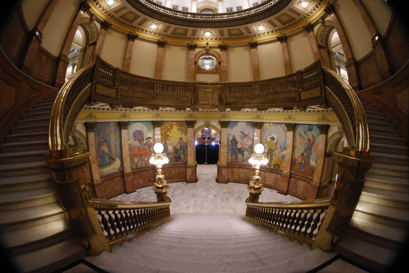 Empty stairs are shown in the rotunda of the State Capitol as the building remains closed to the public as part of the state's efforts to reduce the spread of the new coronavirus Monday, May 11, 2020, in Denver. State lawmakers announced that they plan to return to session in early June. (AP Photo/David Zalubowski)