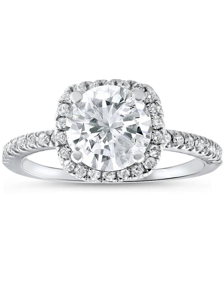 "<p>This 14k white gold <product href=""https://www.walmart.com/ip/2-1-2-cttw-Diamond-Engagement-Ring-Cushion-Halo-Round-Cut-14k-White-Gold/186443962"" target=""_blank"" class=""ga-track"" data-ga-category=""internal click"" data-ga-label=""https://www.walmart.com/ip/2-1-2-cttw-Diamond-Engagement-Ring-Cushion-Halo-Round-Cut-14k-White-Gold/186443962"" data-ga-action=""body text link"">Pompeii3 Diamond Engagement Halo Ring</product> ($3,416, originally $,9280) features brilliant diamonds.</p>"